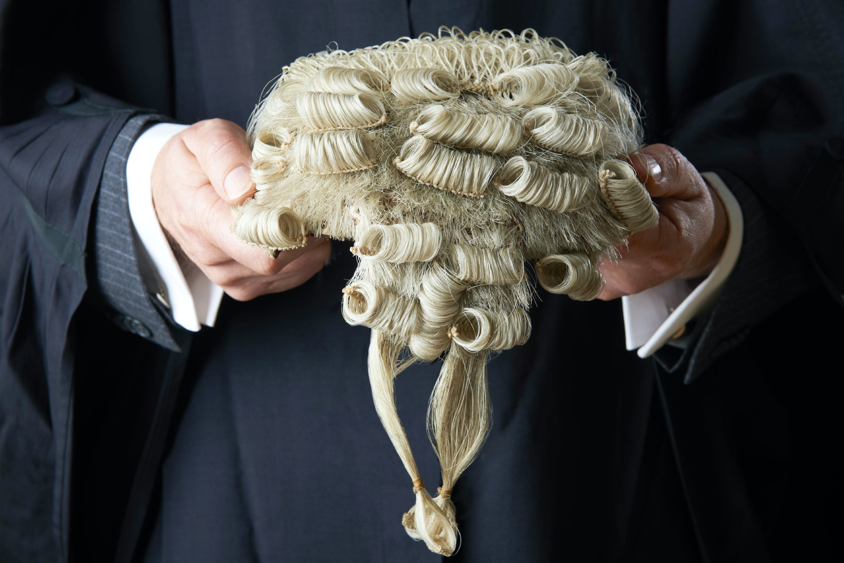 barrister holds a wig, illustrates the successful QC appointments