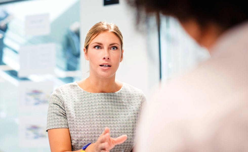 woman taking control in a meeting, to illustrate how to ask for pay rise