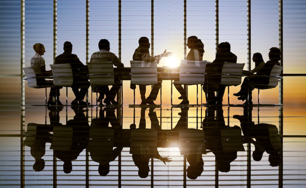 Picture of business people in a meeting, to illustrate partner retirement assistance feature