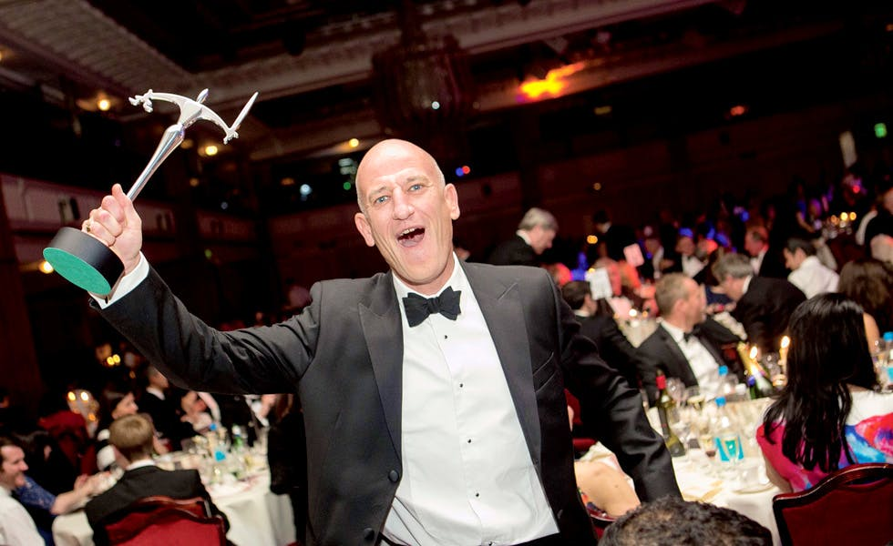 Ray Berg of Osborne Clarke brandishes the Law Firm of the Year 2015 award
