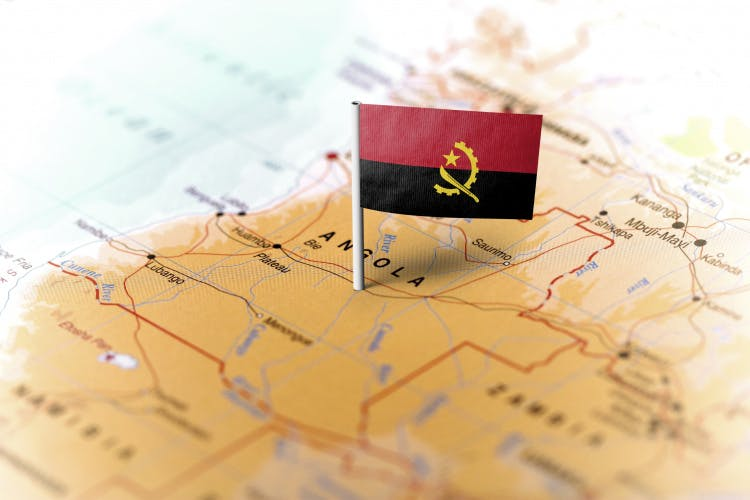 map of Africa with flag planted in Angola