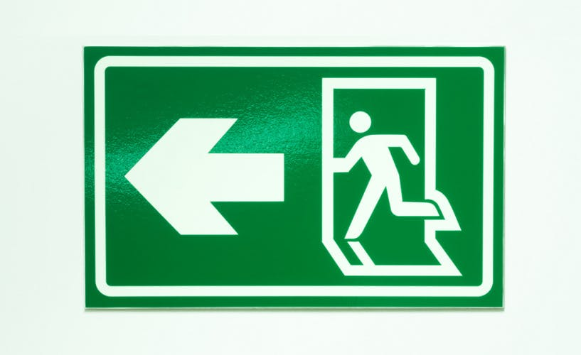 exit sign to denote person leaving