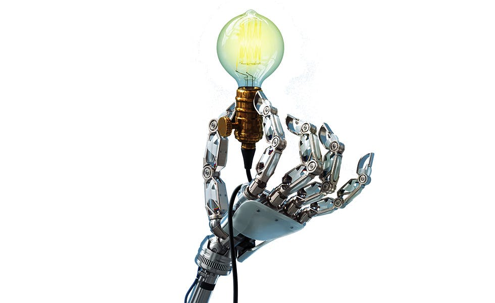 Picture of robot hand holding light bulb, to illustrate article on technology startups Germany law firms