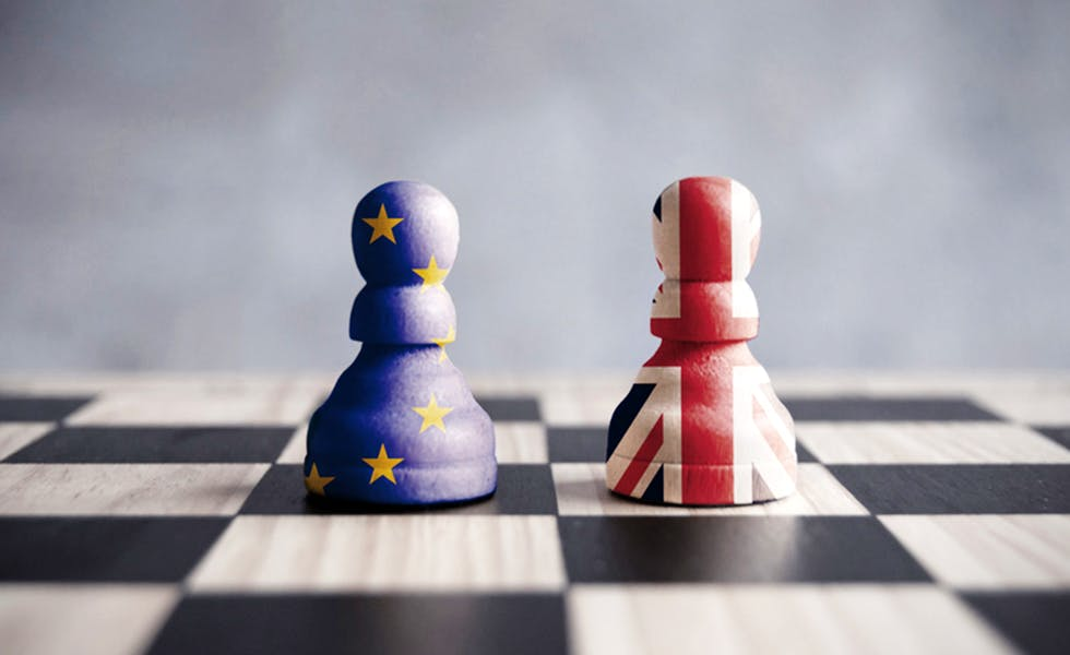 Two chess pawns with UK and European flags to illustrate Brexit strategy planning