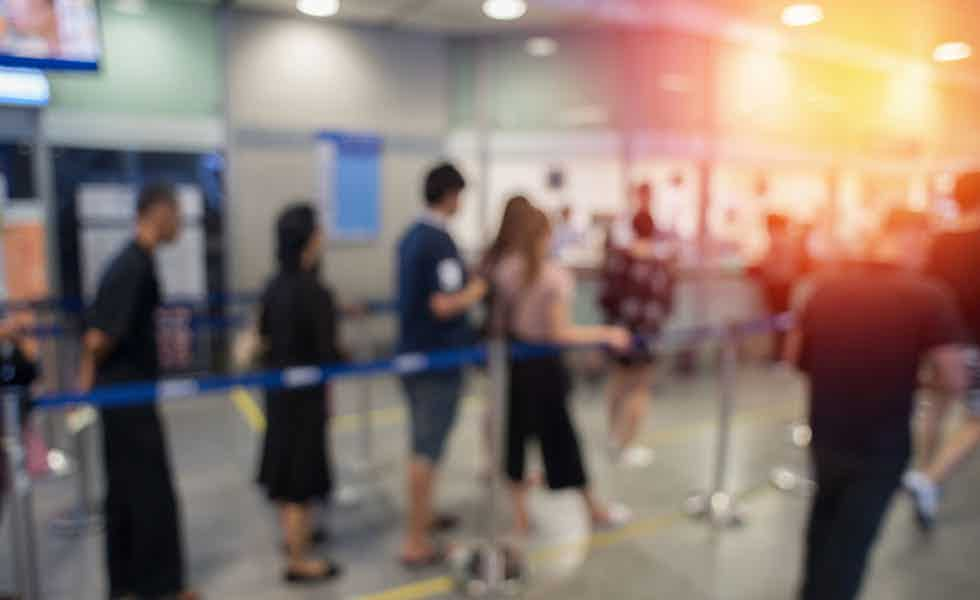 Blurred background queue to illustrate immigration procedure