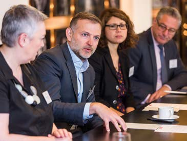 roundtable delegates discuss in-house lawyers manage transformation
