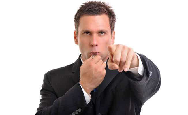Businessman blowing whistle and pointing finger. More in Lightbox