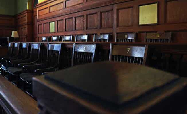 empty jury's box in courthouse